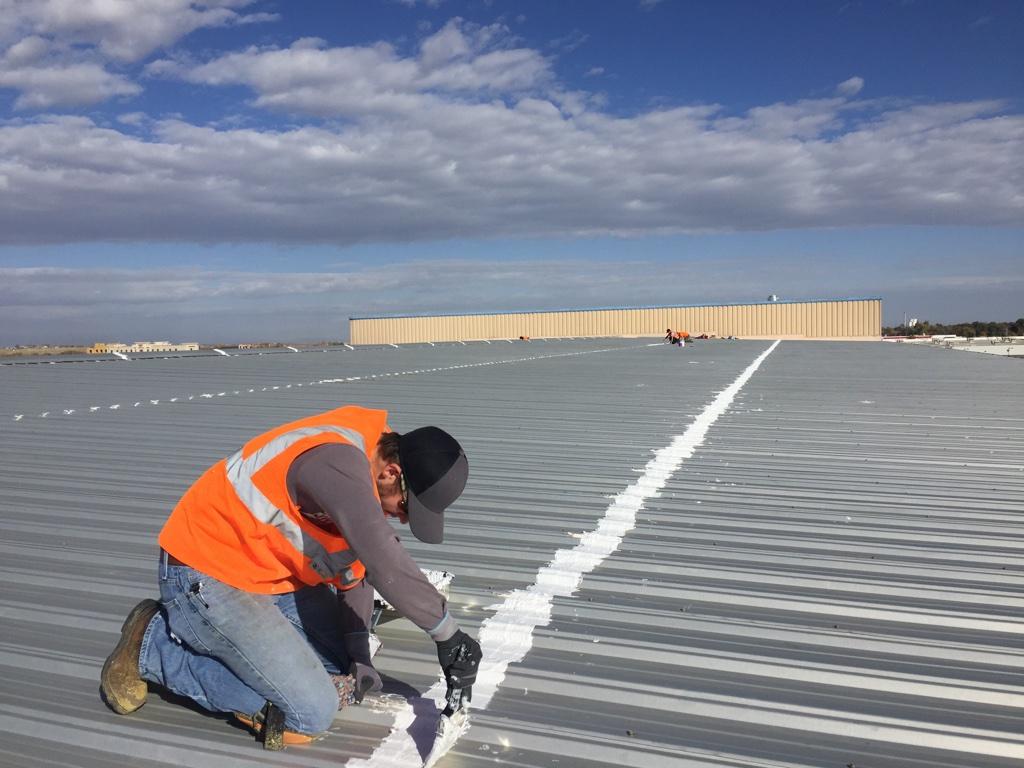 Acrylic roof coating application.
