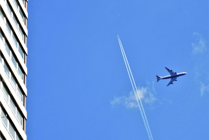 Airplanes leaving vapour trails contributing to a warmer plant