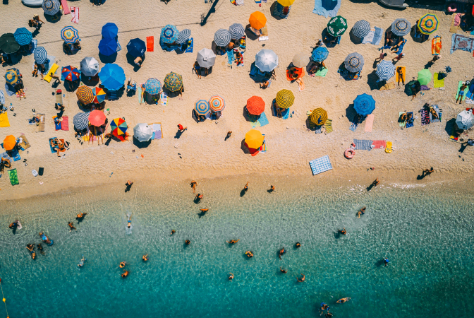 A large group of people vacationing on a beach