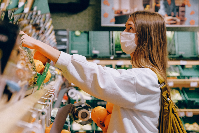 A girl choosing to shop for plant-based groceries