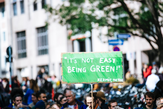 Group of climate activists holding a sign