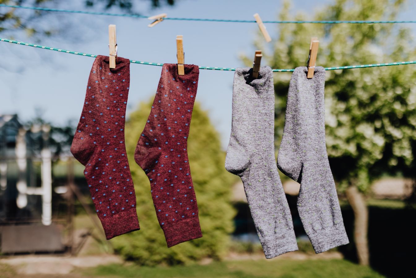 Two pairs of socks on laundy line