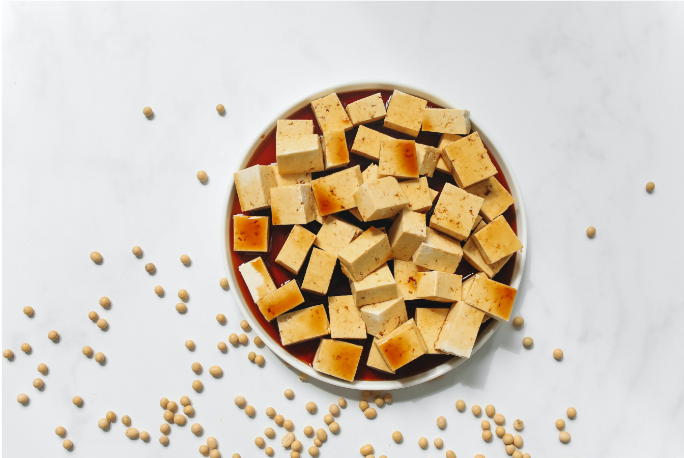 Tofu in a bowl being soaked in soy sauce for a no meat meal