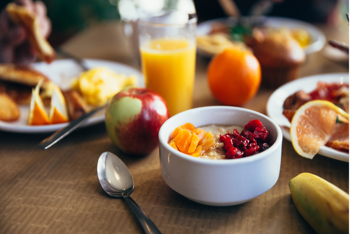 A healthy breakast, consisting of mostly fruits and oatmeal