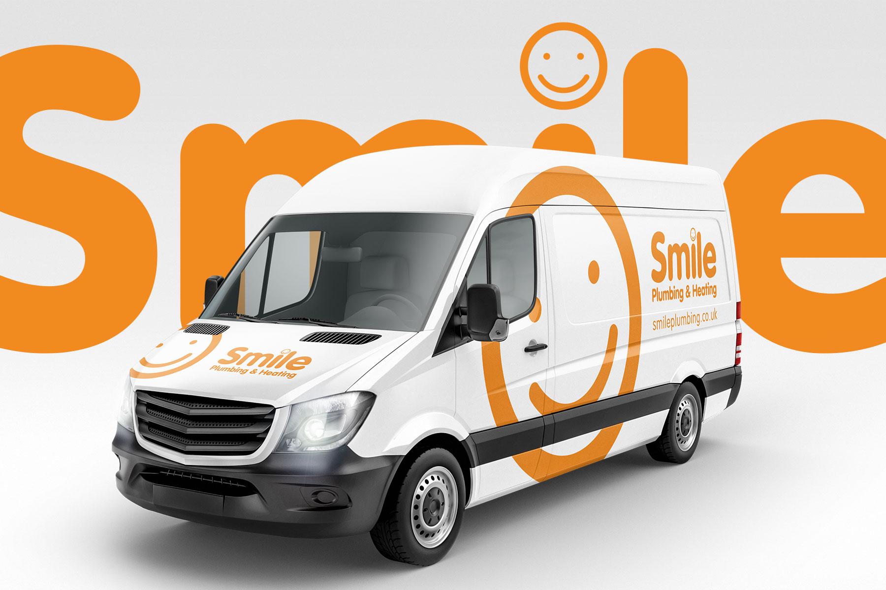 Vehicle graphics for Smile Plumbing branding