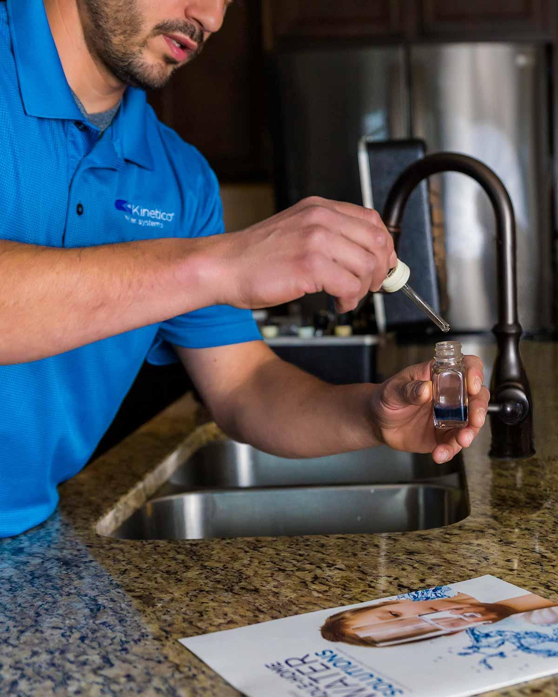 Technician testing water