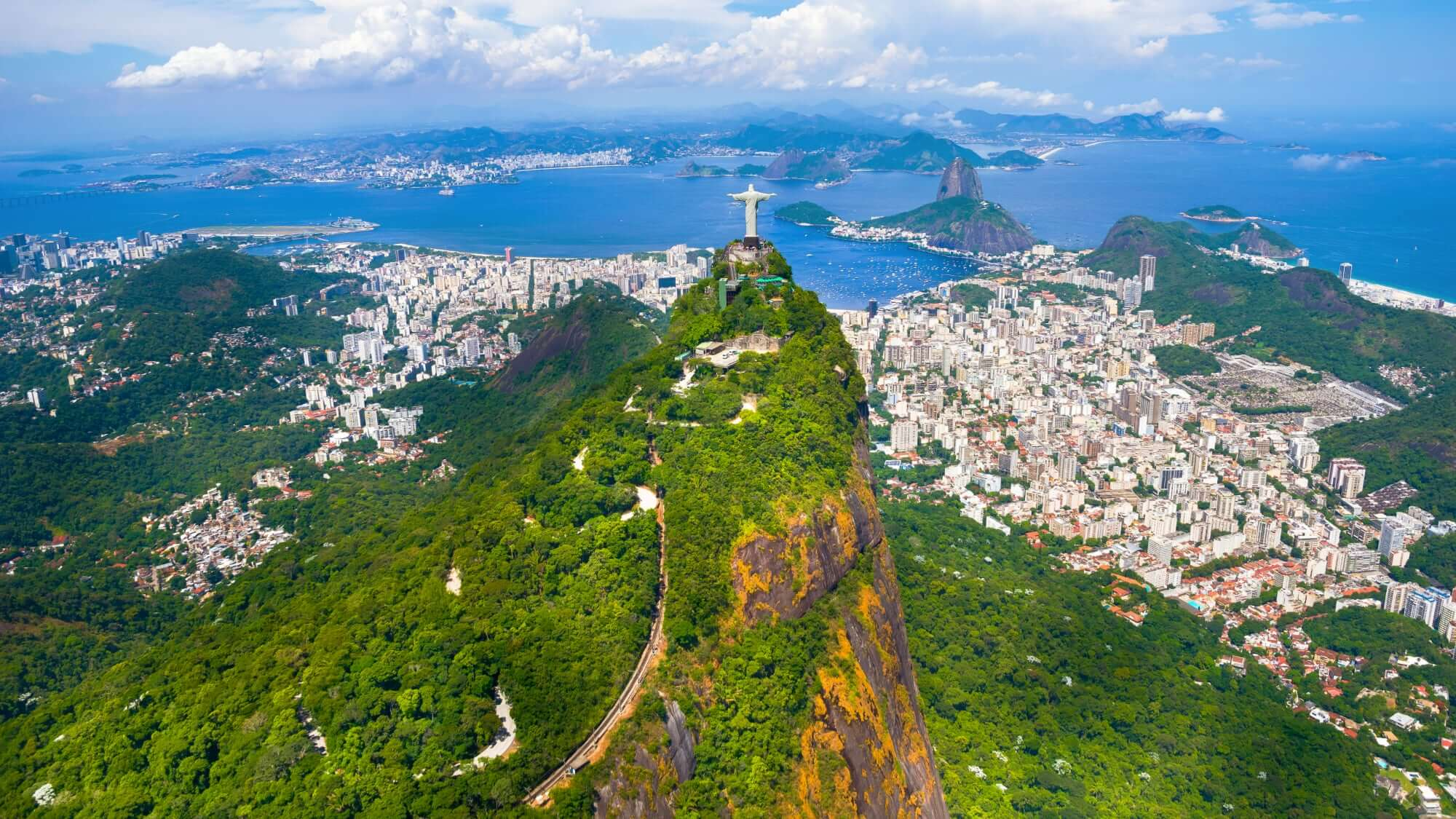 """Corcovado Mountain with the """"Christ the Redeemer"""" Statue and the railway line in front"""