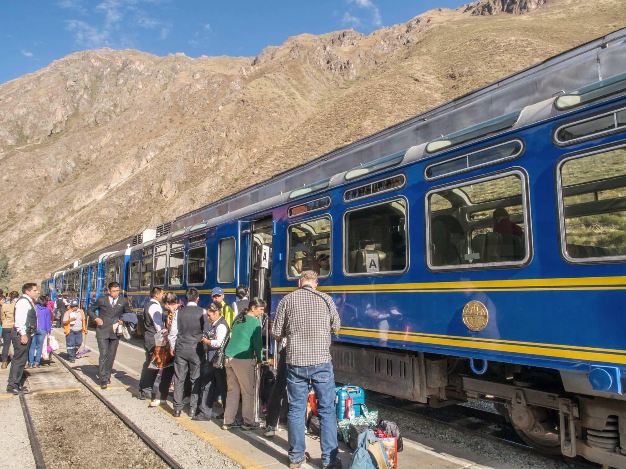 Passenger boarding Vistadome Train in Ollantaytambo