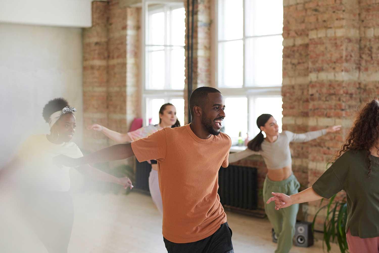 People Zumba dancing in a studio