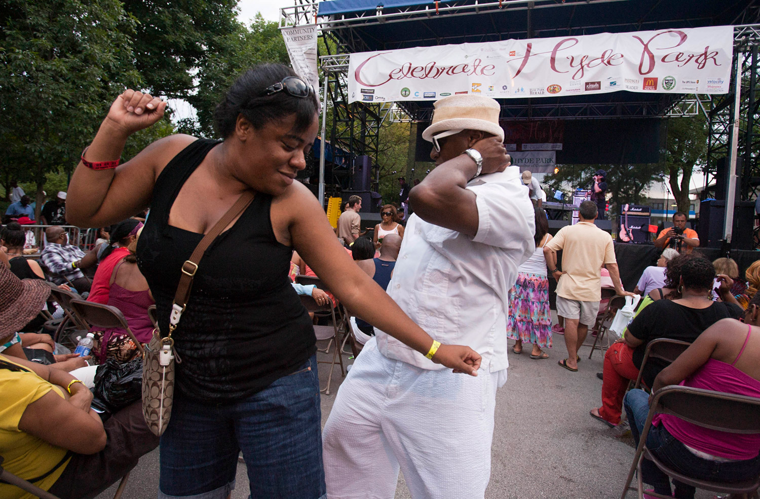 People dancing at an outdoor festival