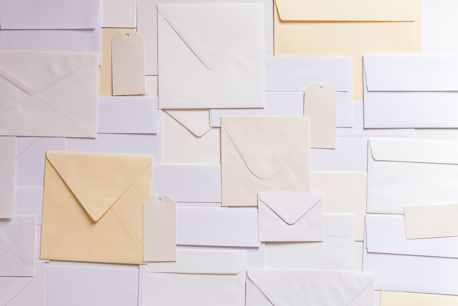 Collage of envelopes of different colors and sizes