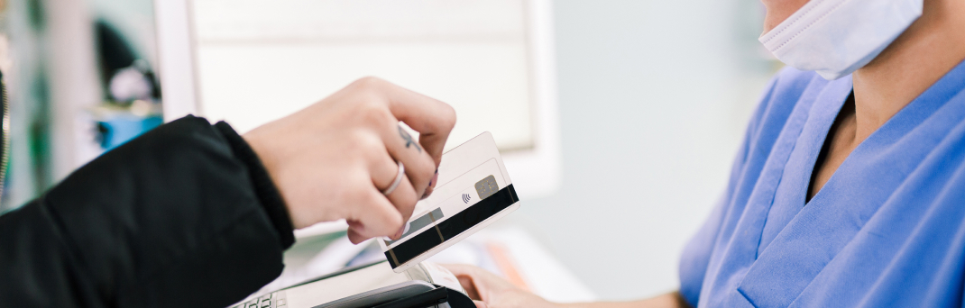 Person swiping card to pay