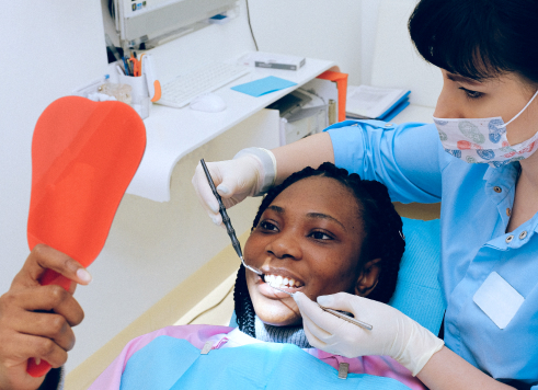 Dentist talking to patient about teeth