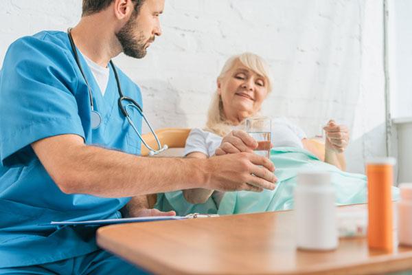 Doctor handing patient water