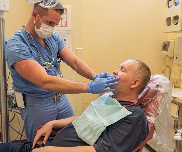 Dentist looking at patients teeth