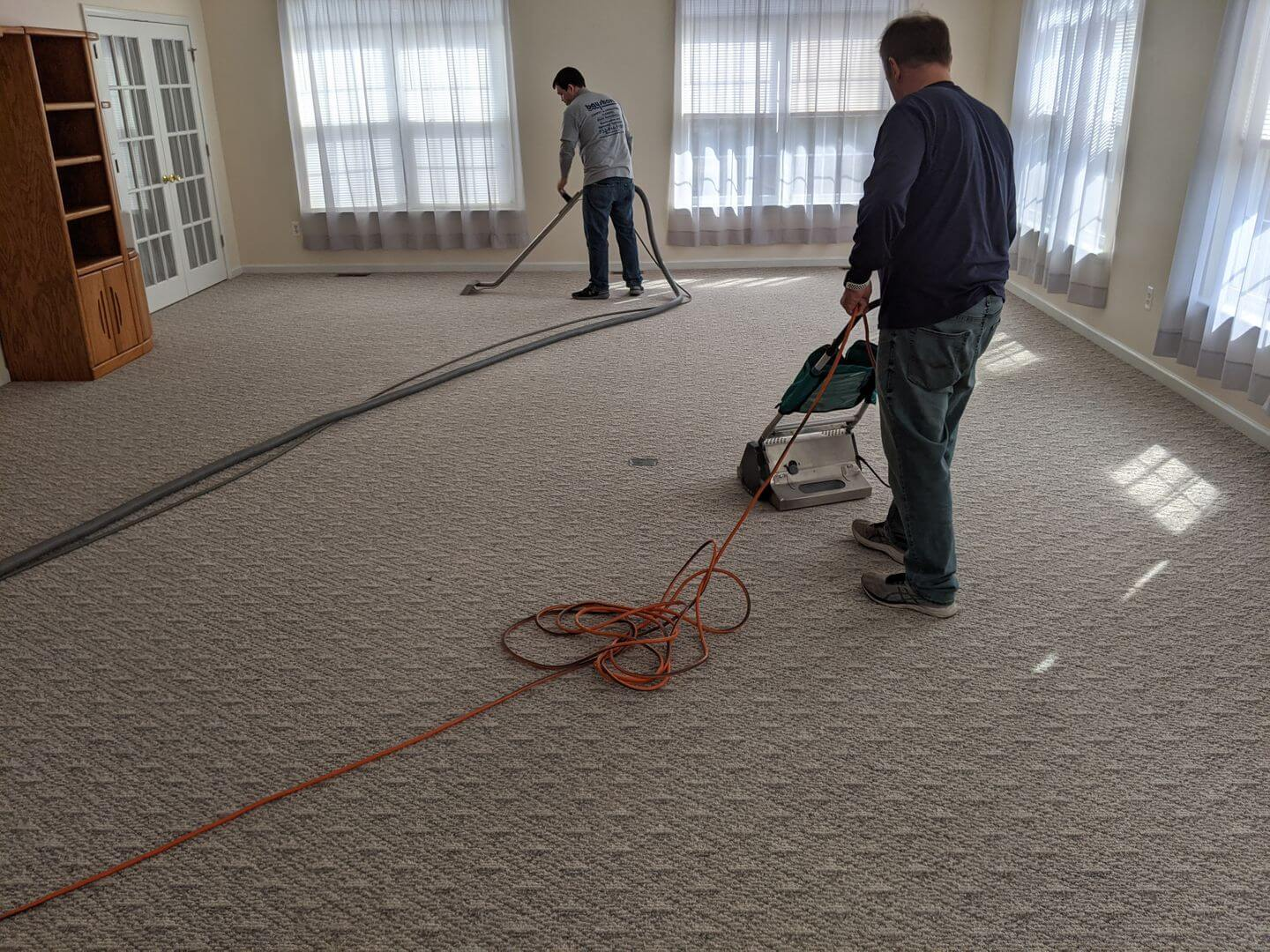 Bay Shore employees vacuuming and deep cleaning carpets in Toms River, NJ