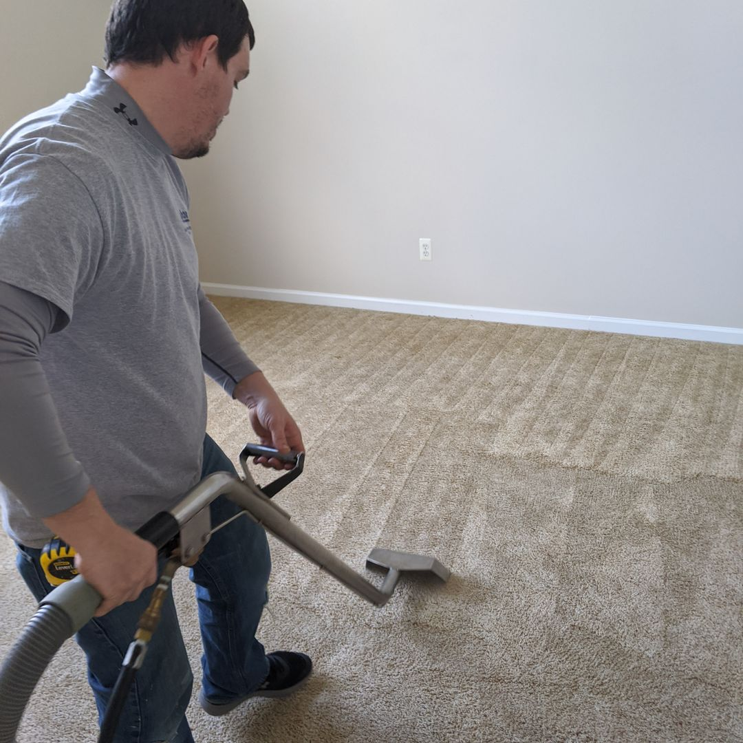 Bay Shore employee vacuuming and deep cleaning residential carpet in Toms River, NJ
