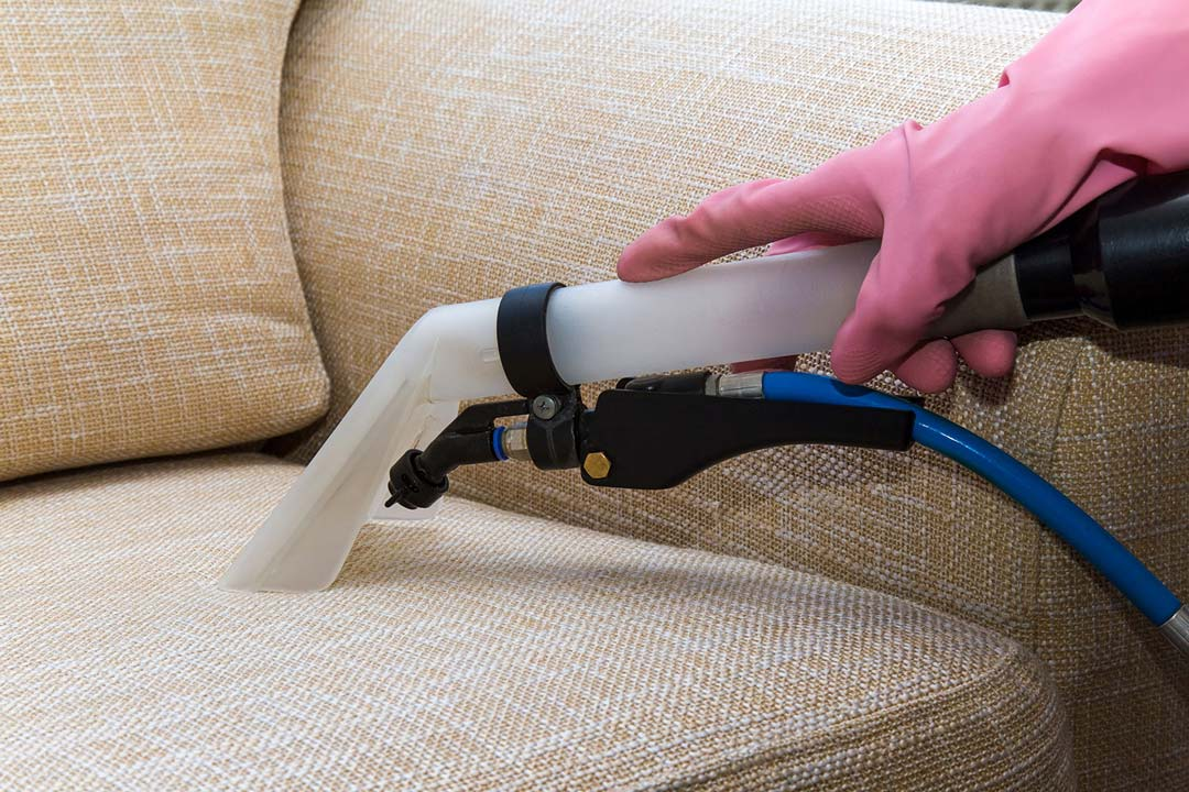 Upholstery being cleaned with small vacuum or hose in Toms River, NJ