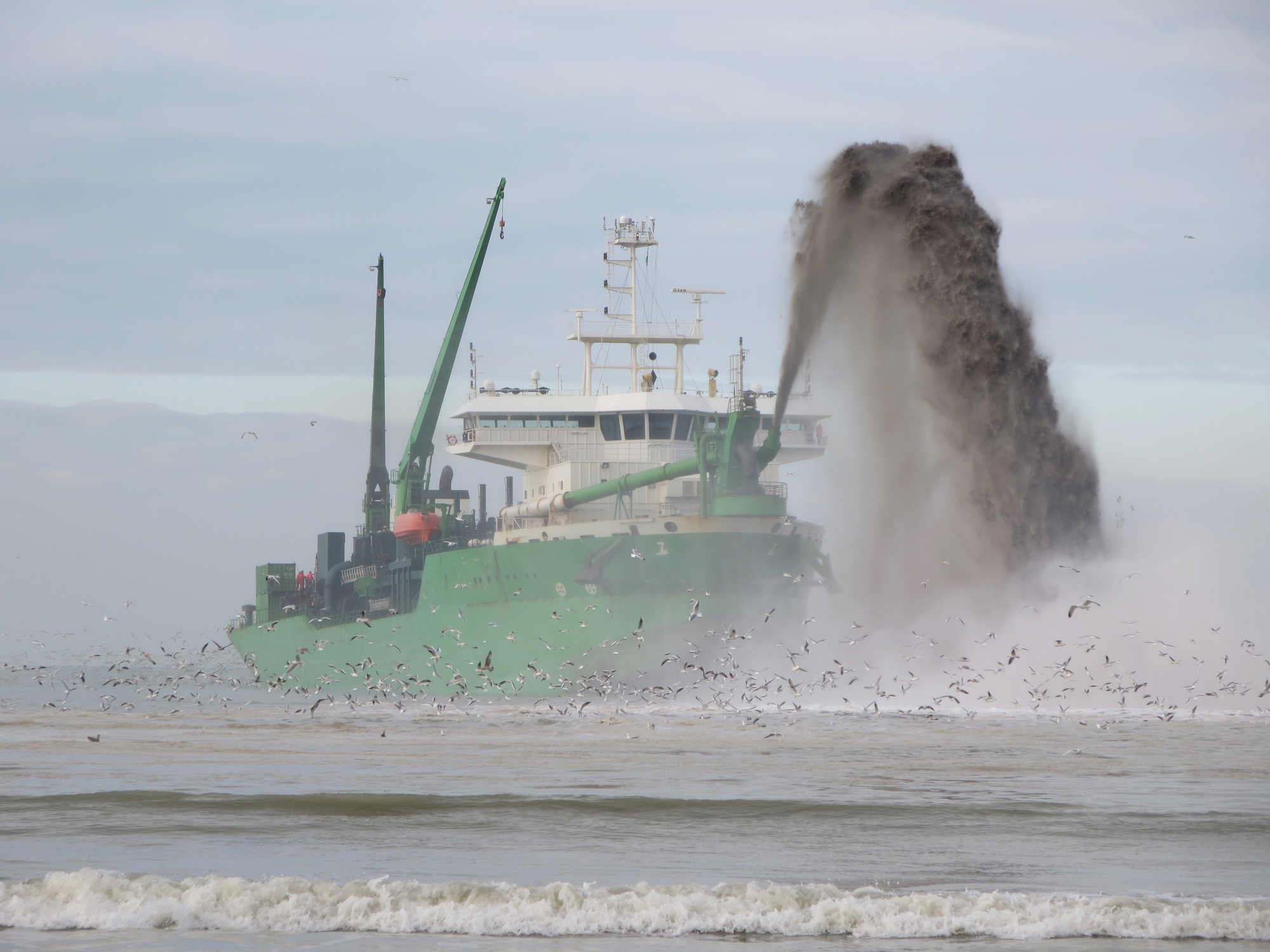 Dredger exavating material from the seabed to increase water depth