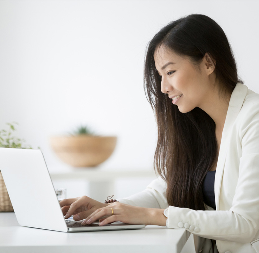 Woman filling out Soberlink form on computer