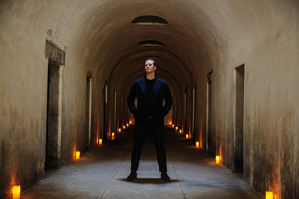 Andrew Ousley stands in the catacombs of Green-Wood Cemetery.
