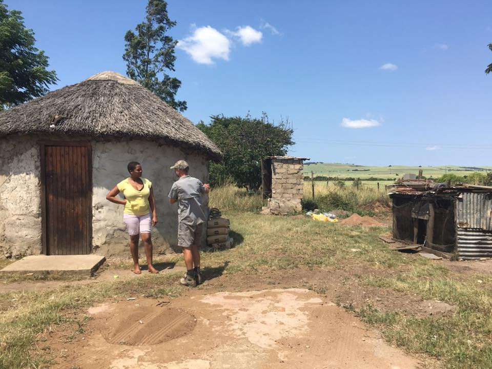 Visiting a family that was given a house many years ago, here in front of the old round hut
