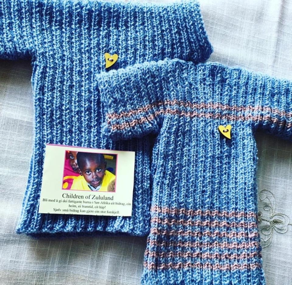 Some of our knitters are adding on some extra accessorize - here a small button