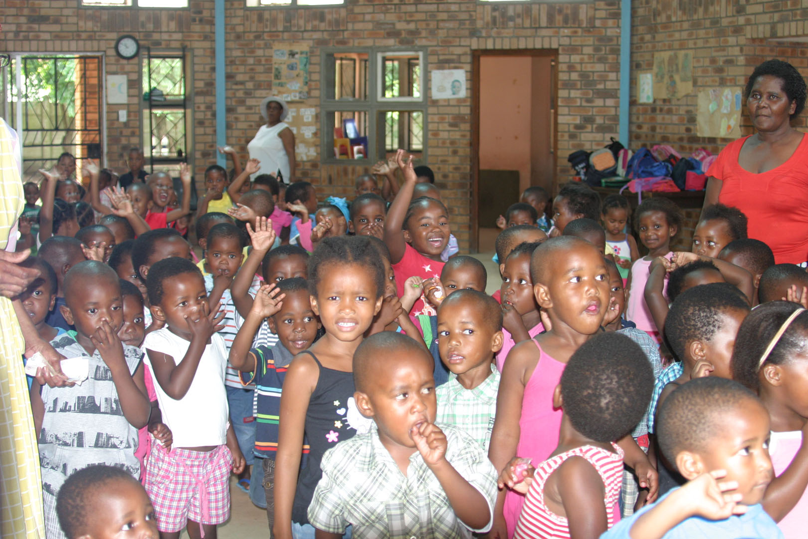 King Dinazulu Creche holds many children, up to 200 in a old one-room warehouse brick building