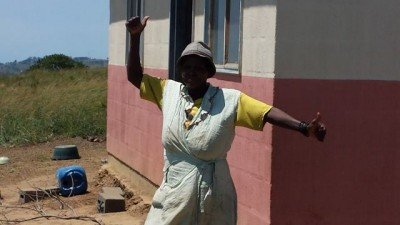 The mother of Sipho is happy to see us visiting every year and welcomes us with dancing and shanting.