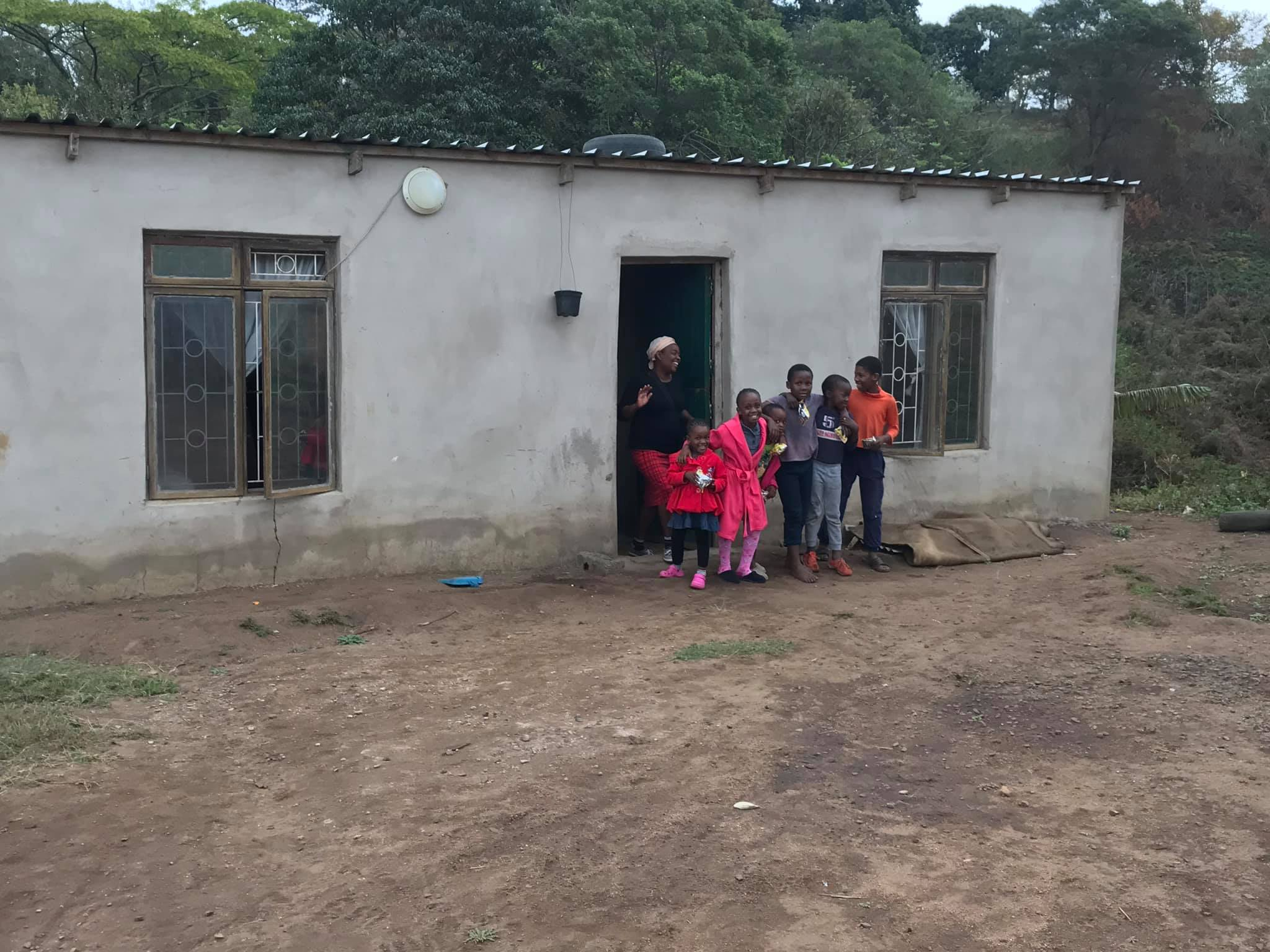 Bongi with some of the grand children at her front door