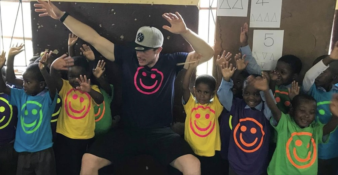 Terje interacting with children at Siphezi, all dressed in our smiley-shirts