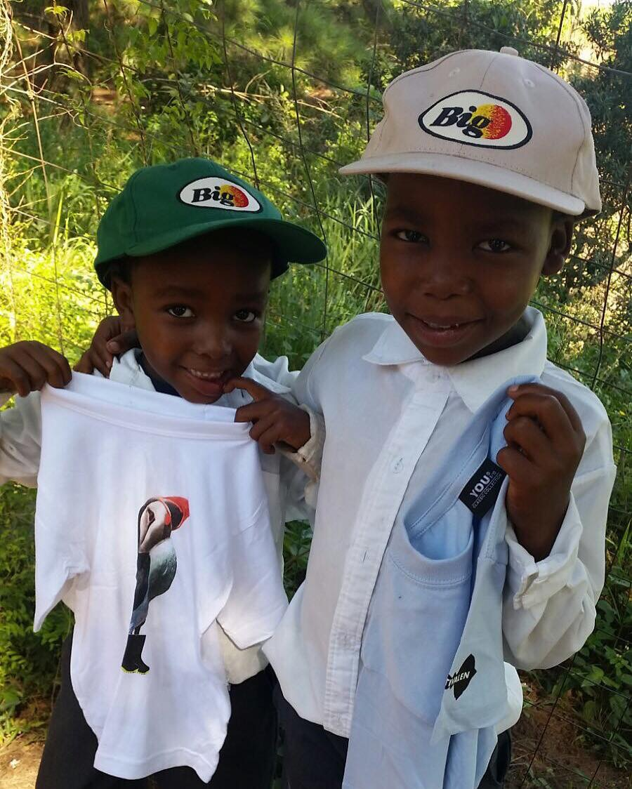 Two little ones with BIG caps and Traena Festival shirts