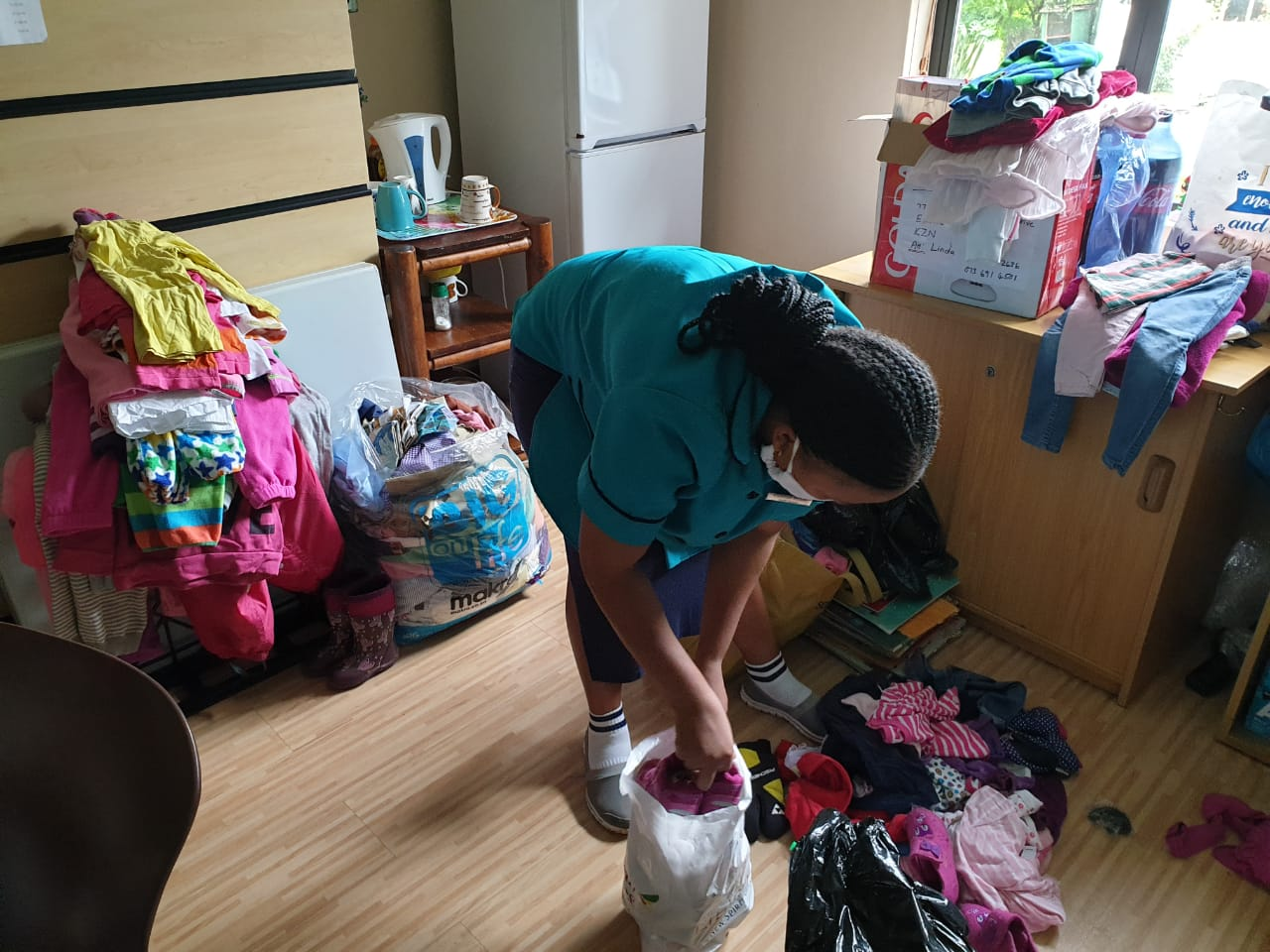 Sorting of clothes before handing out