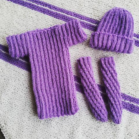 A blanket, a shirt, socks and a hood