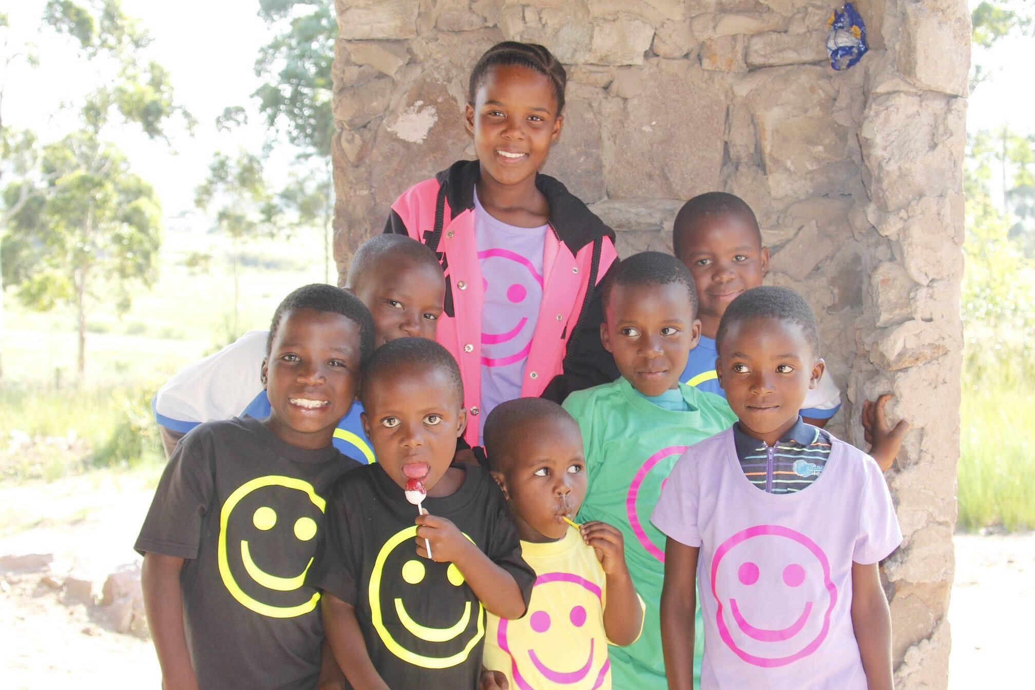 Some of the children in Ezphezi area, with our smiley-shirt