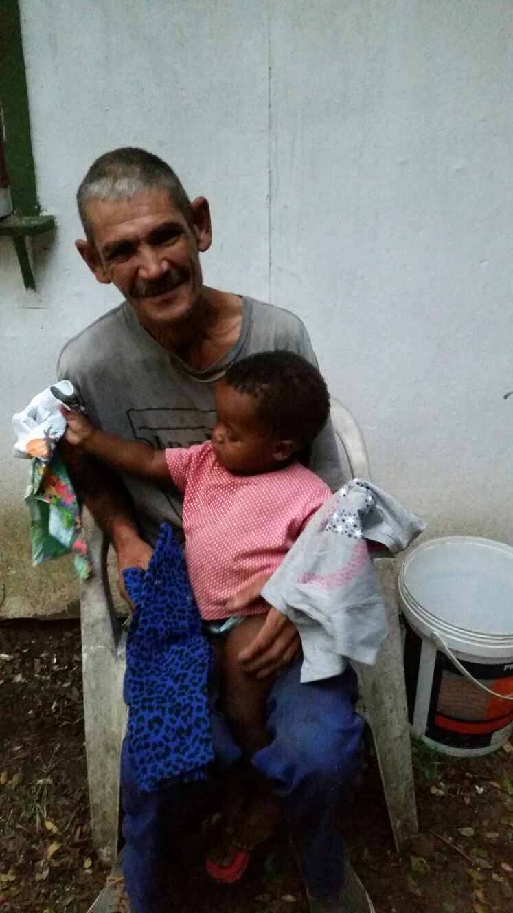 A grand father with his grand child have collected some new clothes
