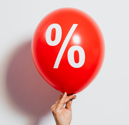 red balloon with white percent sign
