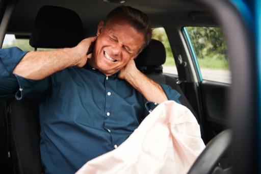 male-motorist-with-whiplash-injury-in-car-crash-wi-5K79C8Y  Waypoint Chiropractic Bozeman MT