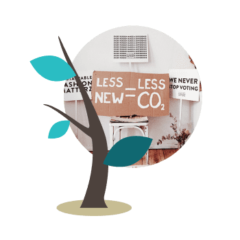 Tree illustration over carboard protest signs that read Less New Less CO2