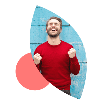 Smiling man celebrating with eyes closed and arms pumped
