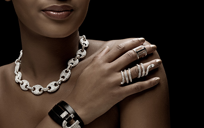 Close up of black woman with bold jewelry