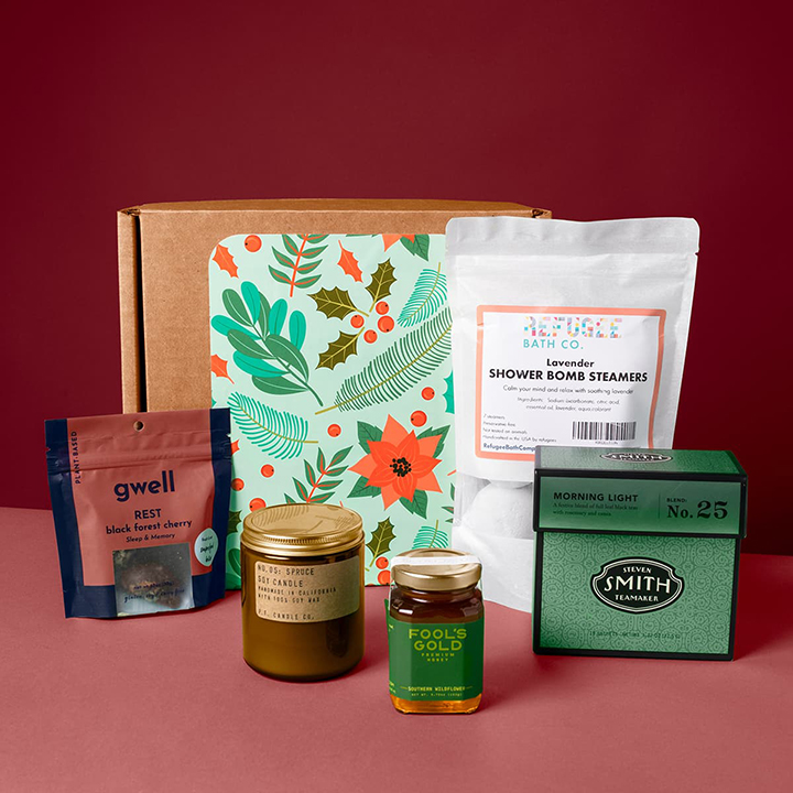 The days are short and the skies are gray, but the recipient of this box will feel a ray of sunshine. Show your care for your team by sending them this wellness-focused box, curated for health & relaxation. Soak it in with shower steamers and a spruce candle, and sip & snack on tea with honey and wholesome snack bites. It's hard to go wrong with this box this particular holiday season.