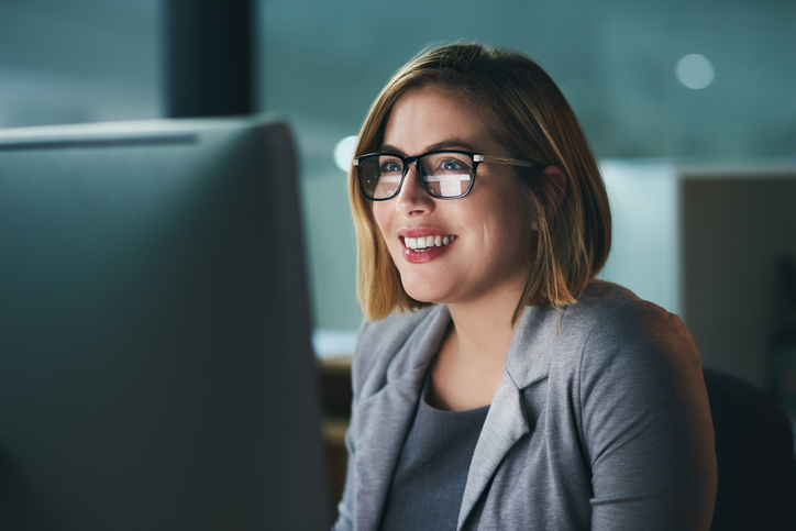 Woman using computer with Joy
