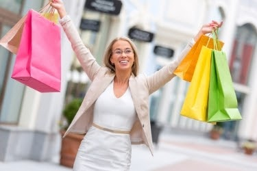 Woman with shopping bags in an outlet