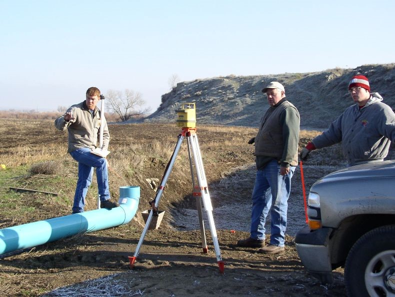 District staff assisting landowners with irrigation project