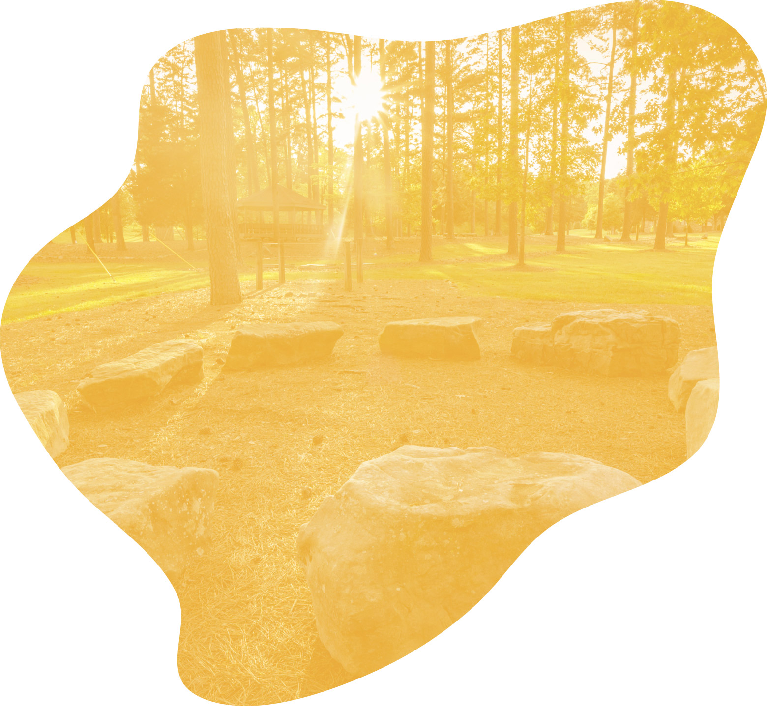 A campsite with stone seats arrayed around an outdoor fireplace. A yellow overlay has been used to stylize the image.