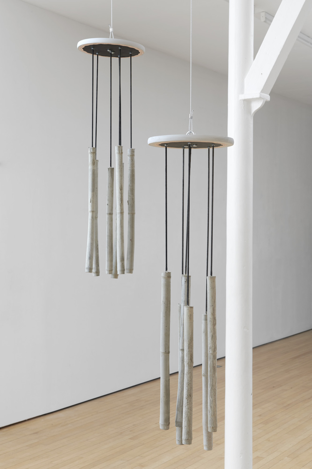 Charlie Godet Thomas, Didi and Gogo, 2019. Motor, steel cable, cast concrete, threaded steel rods, nuts, washers, wood, paint, paper, ink.
