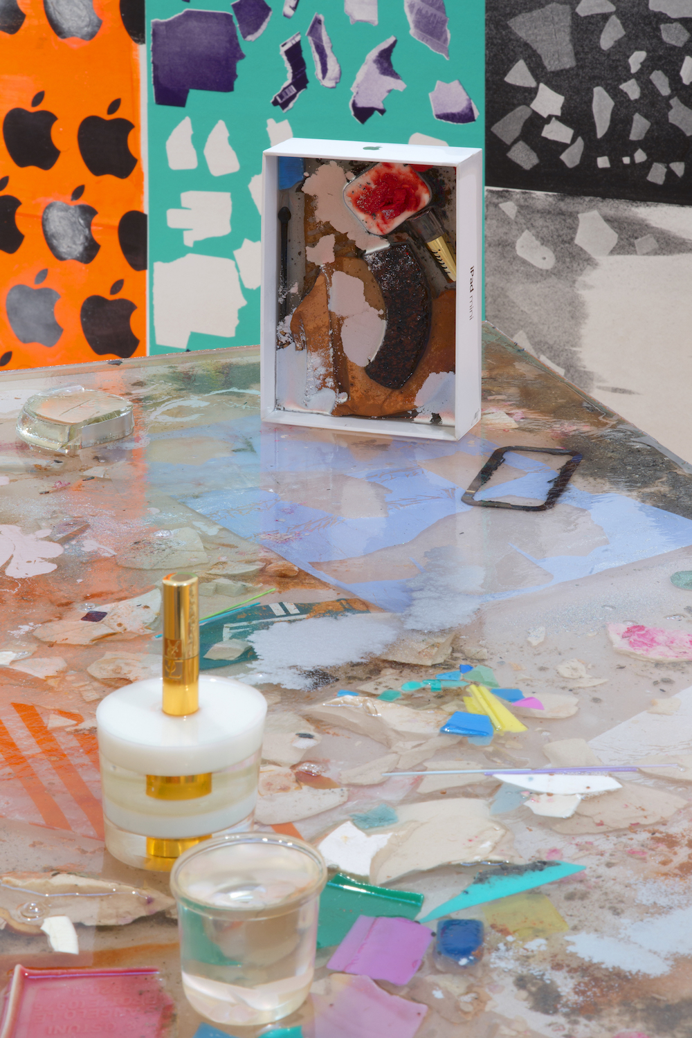 Ludovica Gioscia, Appetite For Great Design (detail), 2014. Resin cast of an Ikea table top, ash, plastic debris, metal, plaster, Ikea table legs, Ipad box, terracotta, make-up, paper, acrylic paint. 93 x 60 x 99 cm.