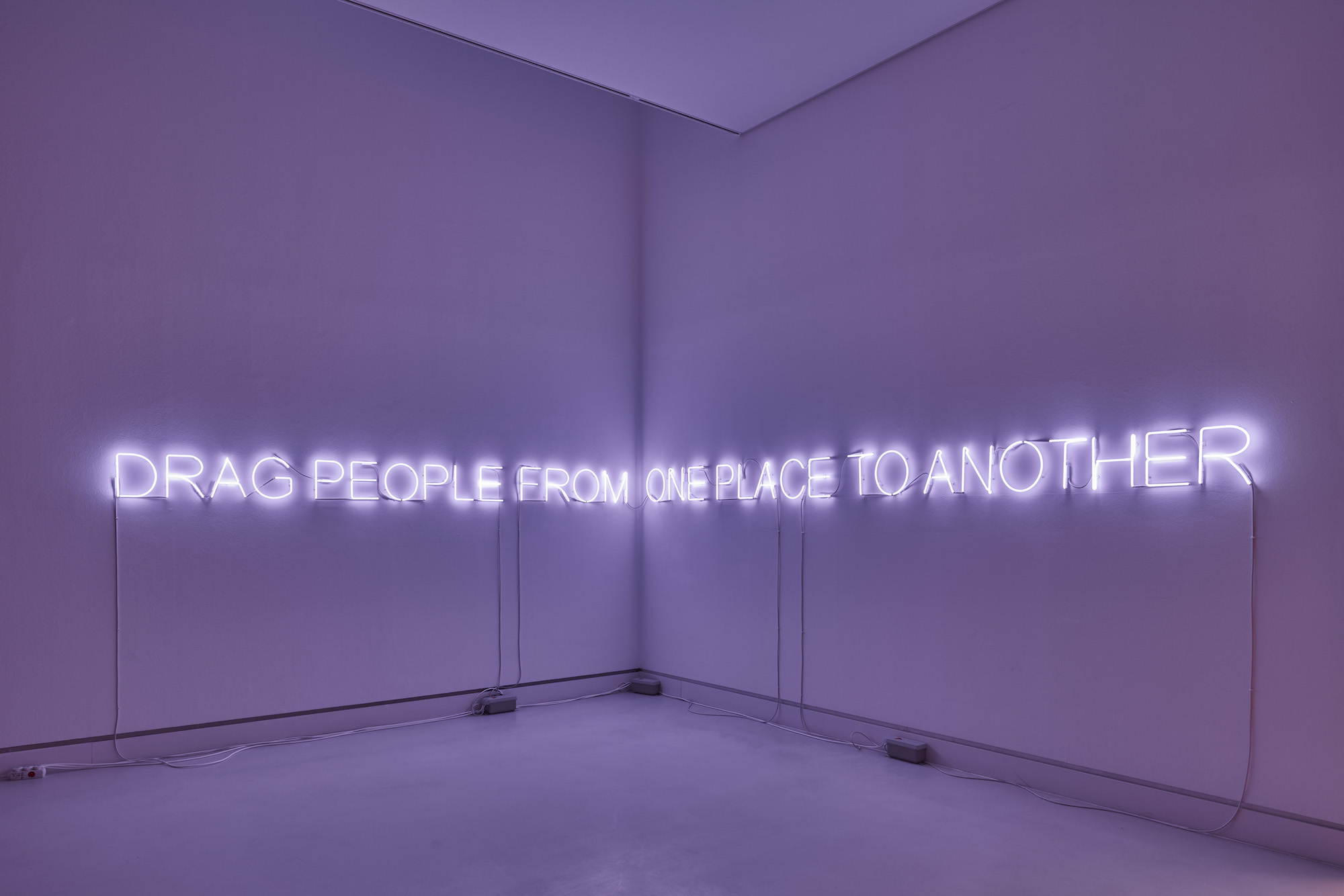 Tim Etchells, ONE PLACE TO ANOTHER, 2019. Neon, three transformers. 23 x 734 cm.