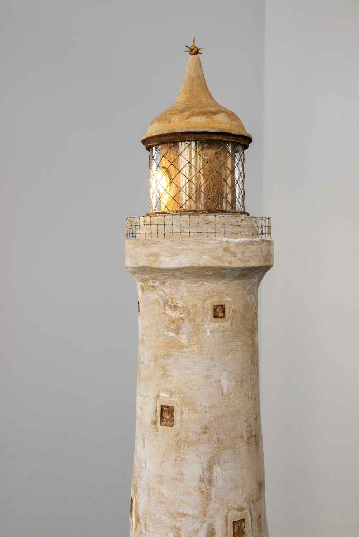 Sam Porritt, Lost at Sea, 2018. Plaster, iron dust, wire, wood, motor, steel, glass, LED bulb. 60 cm (diameter) x 176 cm. Photographer Nici Jost.